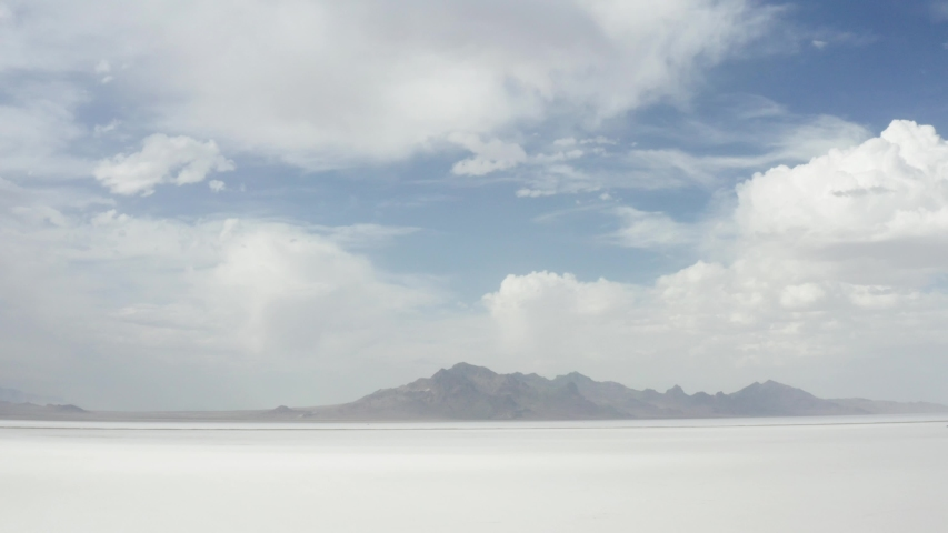 Cinematic aerial of Bonneville Salt Flats, white desert, landscape from another planet, scenic nature of Utah