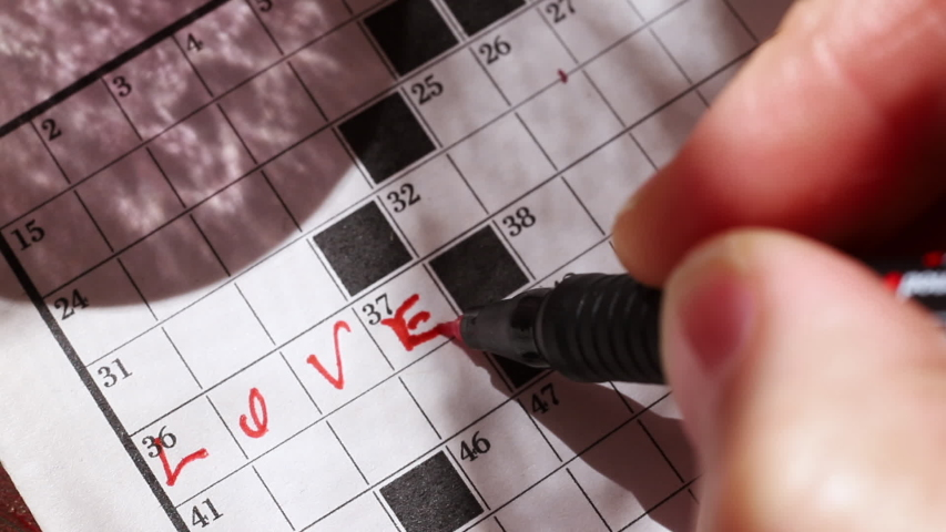 Making a crossword puzzle with red pencil | Shutterstock HD Video #1055251169