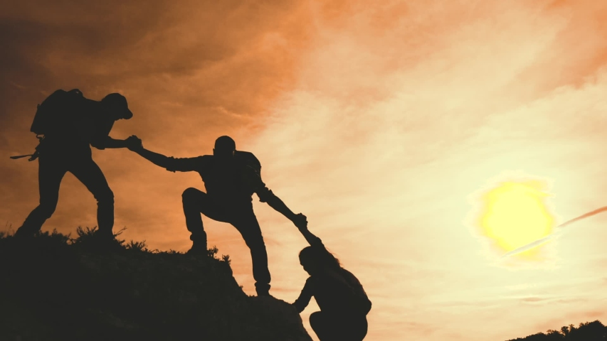 business. teamwork helping hand business travel silhouette concept. group team tourists lends helping hand climb cliffs mountains helping hand. teamwork people climbers climb top overcoming hardships  Royalty-Free Stock Footage #1055264861
