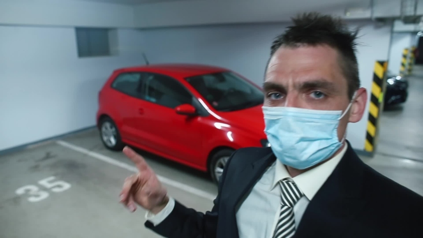 A manager in a mask on face sells car through video blog car. Social distance in car trade. Selling a car at a great distance. Communication in long distance.  Royalty-Free Stock Footage #1055276093