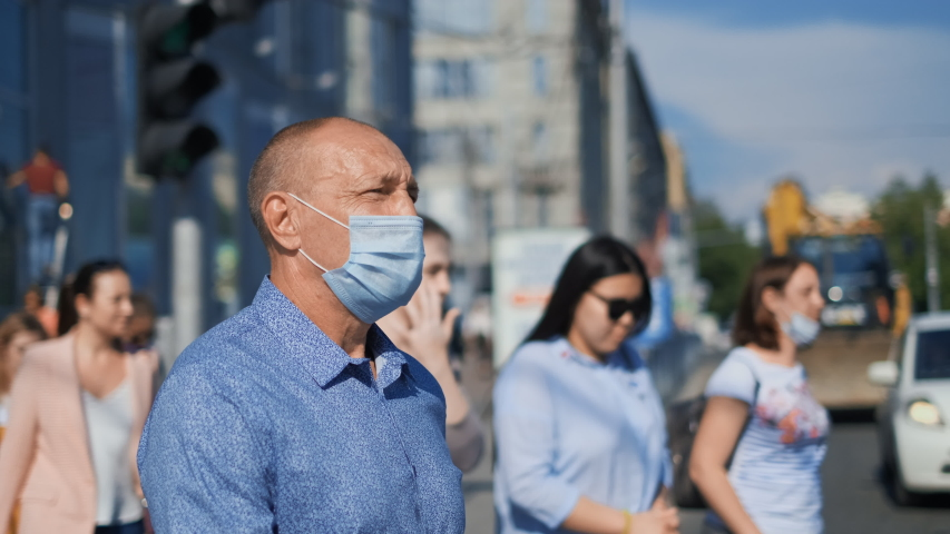 Old age People. Crowd Go Walk in City Street. Respiratory Mask. Older Senior Man. Pandemic Covid-19. Corona Virus mers. Elder Aged Human. Epidemic Coronavirus. Masked olderly Face. Covid 19. Crowded. Royalty-Free Stock Footage #1055276663