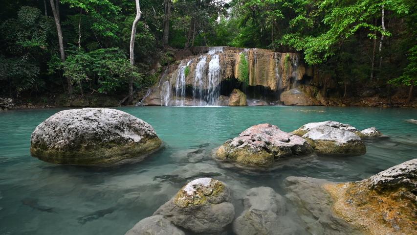 Beautiful deep forest tropical climate waterfall emerald pool of Erawan national park in Kanchanaburi province Thailand