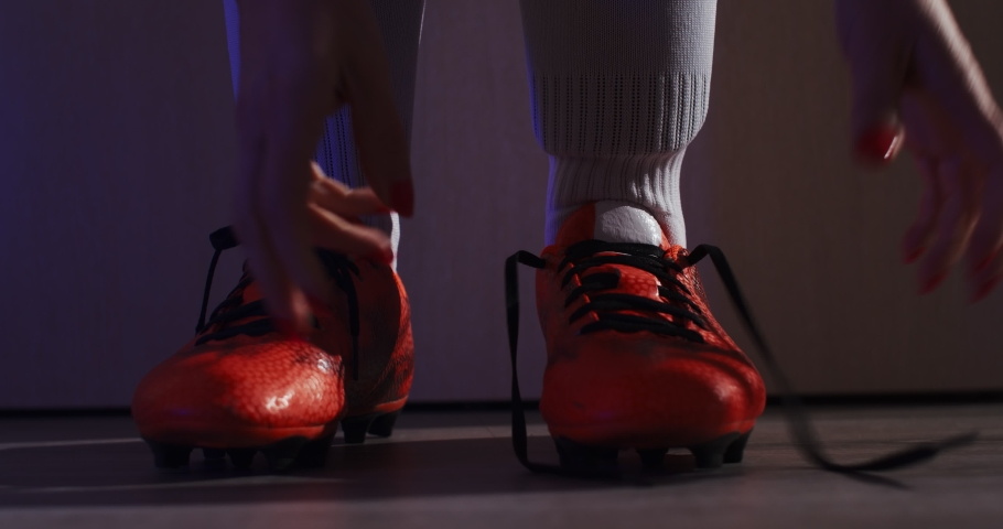 Female soccer football. Professional soccer football woman player put on her shoes. 4k Slow Motion | Shutterstock HD Video #1055282111