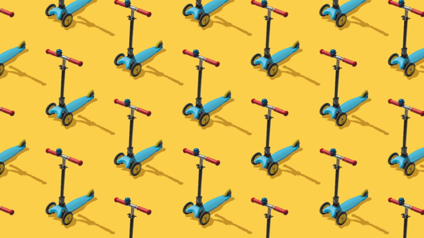 Animated background from large group of kick scooter on yellow background.  Scooters ride diagonally from top to bottom. Flat lay, top view. Isometric view. Seamless loop video.  | Shutterstock HD Video #1055287646