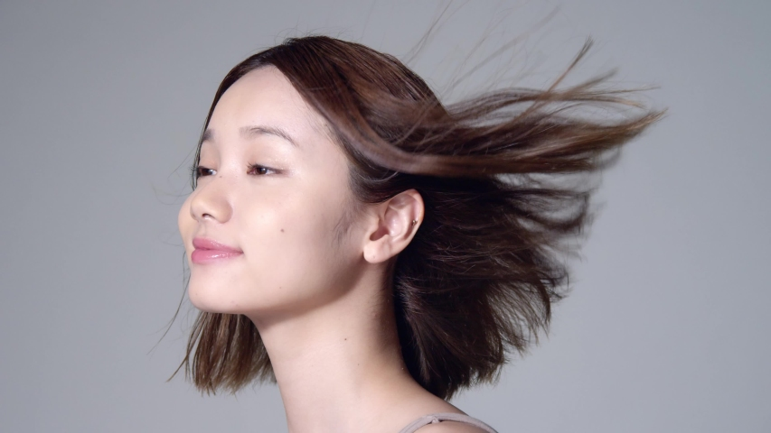 Beauty concept of an asian girl. Hair care. Skin care. Cosmetics. 60p slow motion.