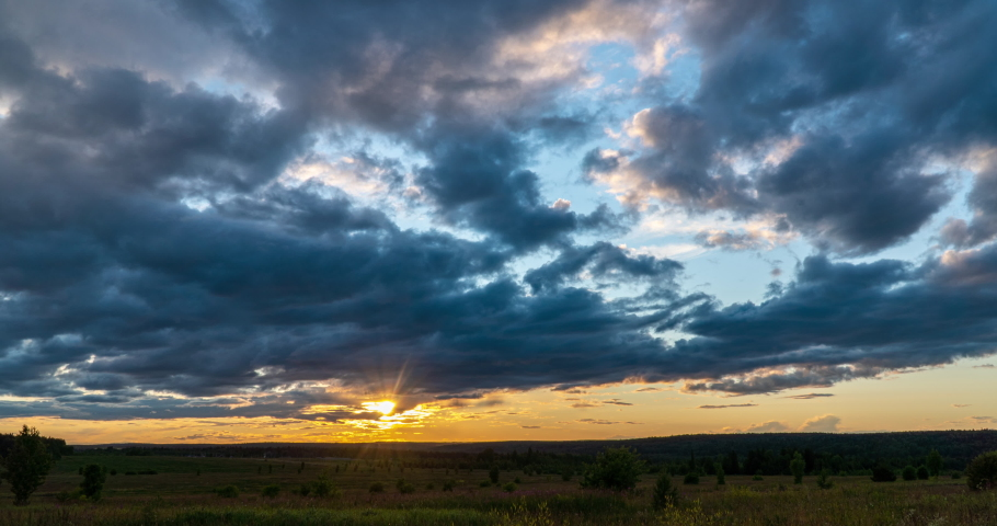 4K Time lapse, beautiful sky with dark blue clouds background, Clouds at sunset. Sky with clouds, weather, nature, cloud blue, the rays of the sun shine through the clouds | Shutterstock HD Video #1055293529