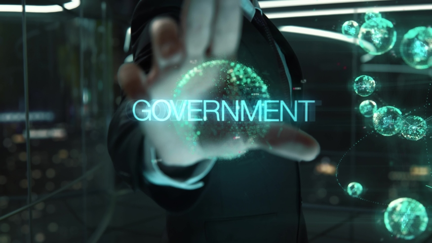 Businessman with Government hologram concept | Shutterstock HD Video #1055296367
