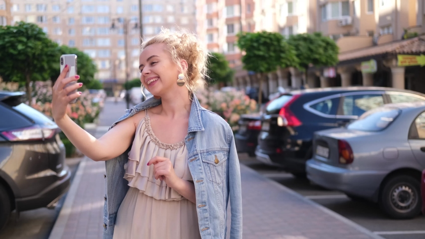 Young blond girl talking on the phone, happy and smiling woman | Shutterstock HD Video #1055297714