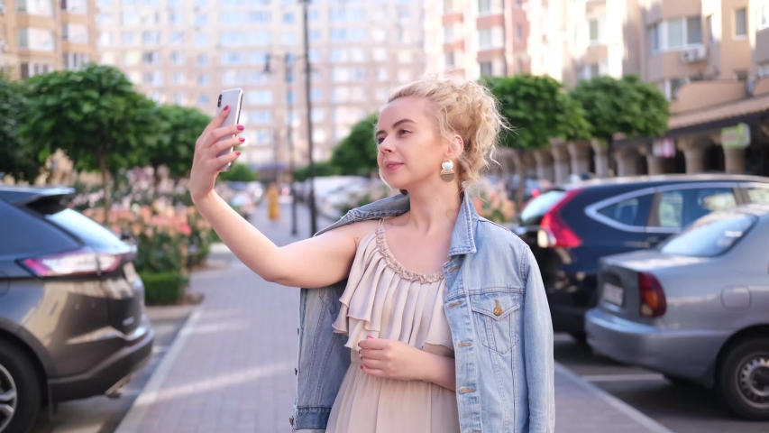Young blond girl talking on the phone, happy and smiling woman | Shutterstock HD Video #1055297720
