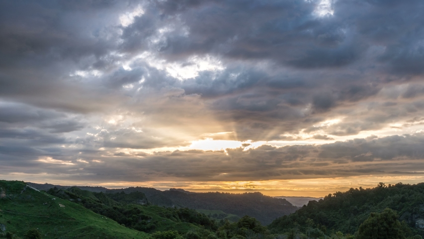 Dramatic sunset sky with sunbeam light in New Zealand wild nature landscape Time lapse | Shutterstock HD Video #1055300393
