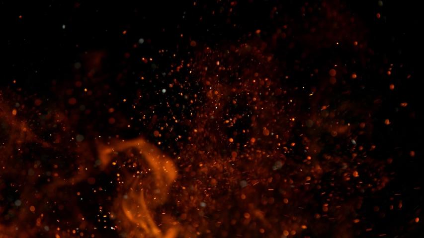 Super slow motion of fire sparks isolated on black background. Filmed on high speed cinema camera, 1000 fps
