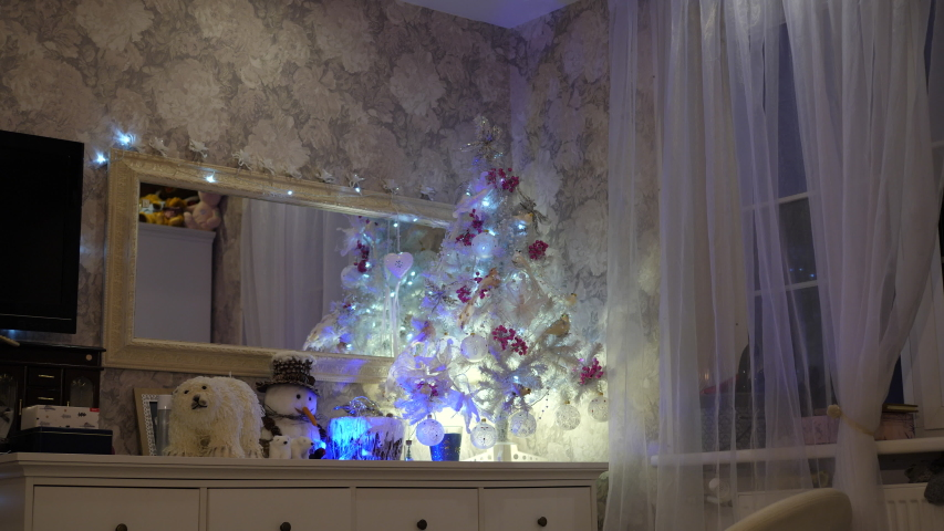 White Luxury Christmas Tree. Family home, room interior decorative gift presents. Snowman and polar bear. | Shutterstock HD Video #1055311226