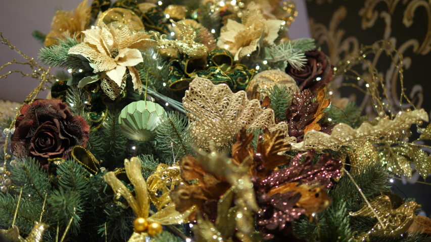 Glitter Christmas Tree. White leafs and brown flowers. Isolated. | Shutterstock HD Video #1055312066