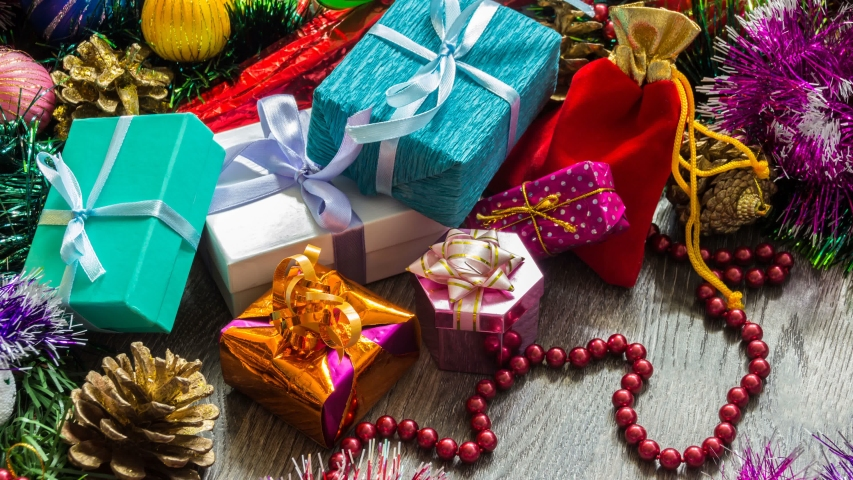 Gifts for Christmas (New year), bright boxes and bags with gifts among Christmas toys and tinsel | Shutterstock HD Video #1055314046