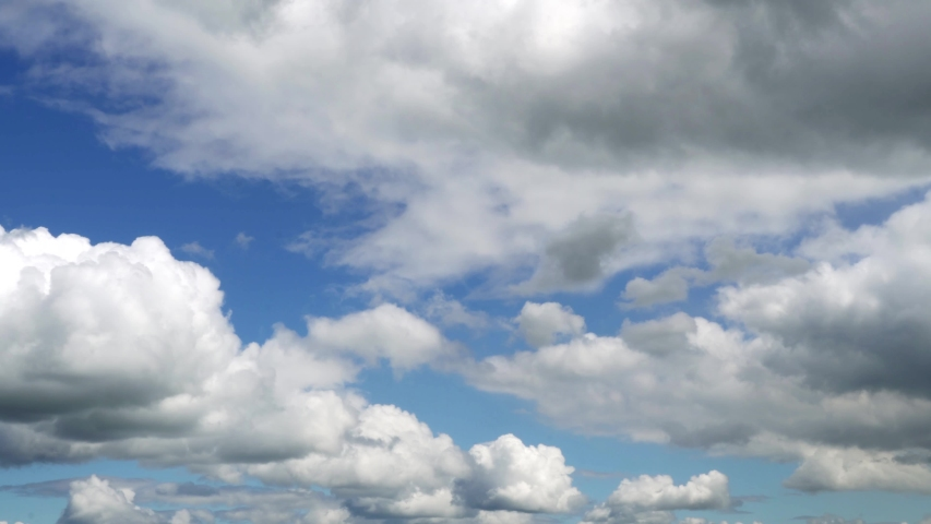 White clouds running over blue sky in sunny day. Timelapse  | Shutterstock HD Video #1055314799
