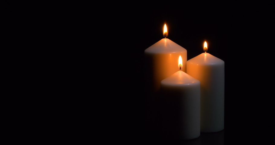 Three extinguished candles with smoke on a black background | Shutterstock HD Video #1055315480