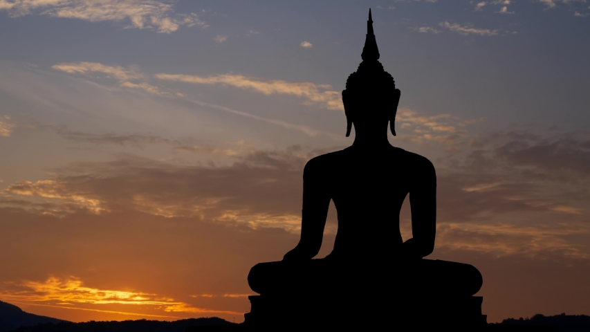 Buddhism: Ancient Statue of Buddah at Sunrise, Time Lapse with Colorful sky, Bangkok, Thailand | Shutterstock HD Video #1055315537