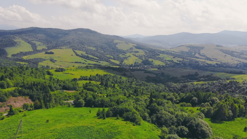 Aerial Flying over a forest of green trees. Background of green trees. Drone footage | Shutterstock HD Video #1055316380