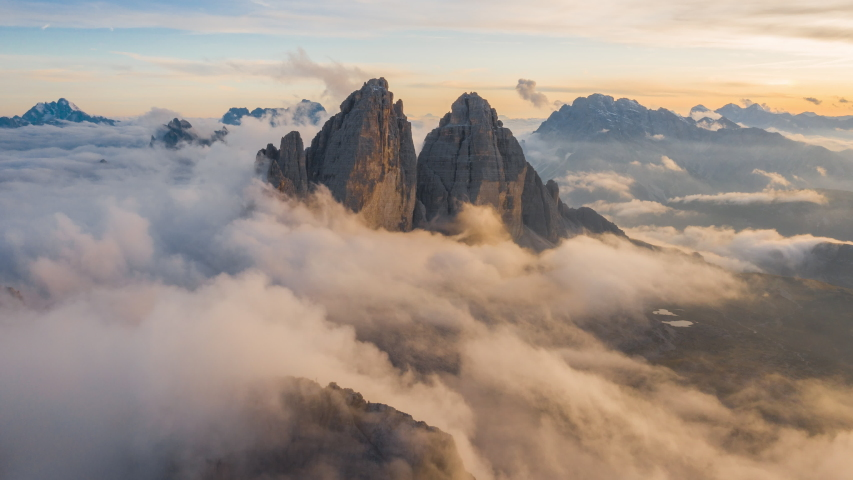 4K, 10BIT, YUV422 timelapse of Tre Cime National park or Three Peaks in sunset with cloud sea and colorful light, Dolomites,the Alps, Italy