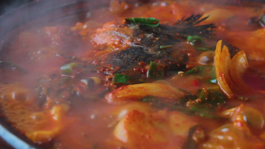It is Korean food. It is a maeuntang cooked with fish, mushrooms, and vegetables that live in fresh water. | Shutterstock HD Video #1055318645