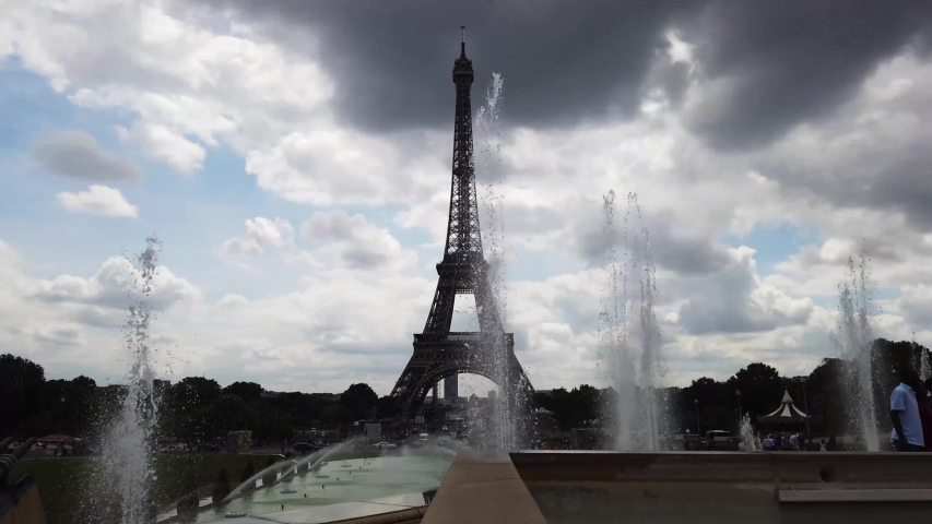 View of Eiffel Tower from Trocadero fountains, Paris, France   Shutterstock HD Video #1055318729