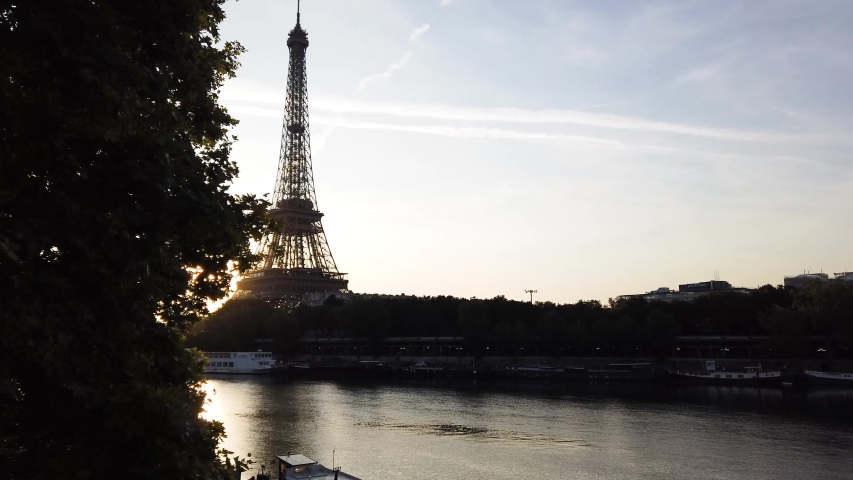Paris Eiffel Tower and Seine river at sunrise in Paris, France. Eiffel Tower is one of the most iconic landmarks of Paris.   Shutterstock HD Video #1055318735