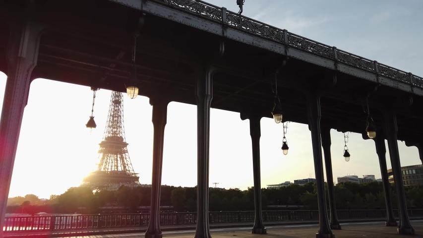 Paris landmark - Bir Hakeim Bridge and Eiffel tower at sunrise, Paris, France   Shutterstock HD Video #1055318783