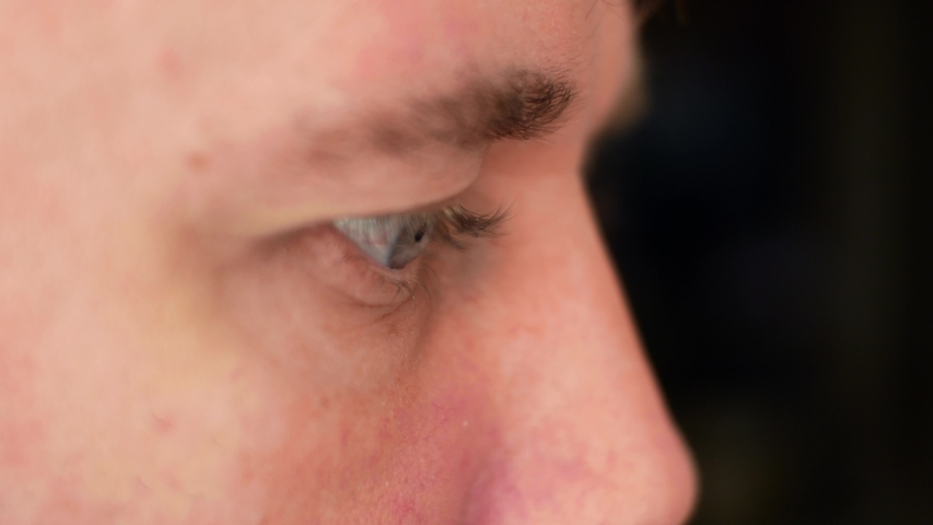 Organs of sight of human. A man moves his eyes with red vessels and watching    Shutterstock HD Video #1055336018