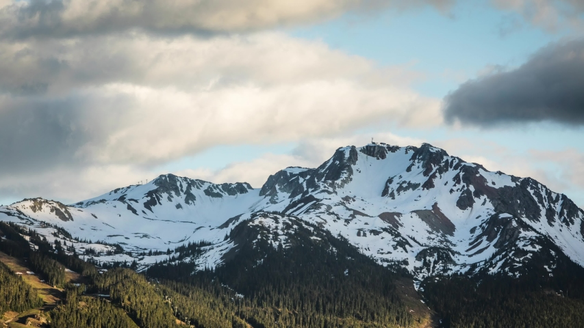 Timelapse of clouds rolling over Whistler mountain peak in Whistler, BC. | Shutterstock HD Video #1055343146