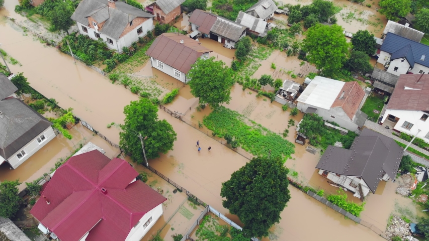 Aerial view Floods and flooded houses. Mass natural disasters and destruction. A big city is flooded after floods and rains.