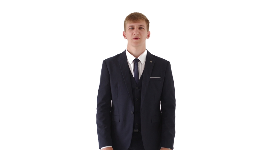 Portrait of a young man in a business suit with blond short hair, expresses certain dislike, is disgusted, does not want, shows gestures with arms crossed, saying NO on a white background.Businessman