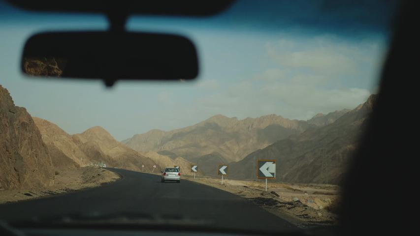 Road trip by highway in desert. Adventure Travel in a desert road in Egypt, full hd | Shutterstock HD Video #1055356910