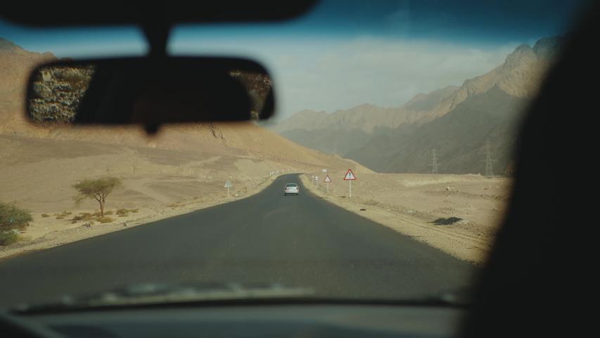 Road trip by highway in desert. Adventure Travel in a desert road in Egypt, full hd | Shutterstock HD Video #1055356928