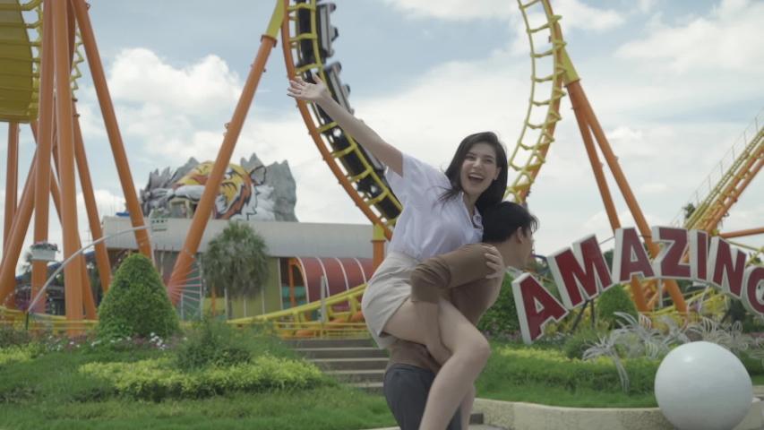 Couples, men and women, travel, amusement park | Shutterstock HD Video #1055359496