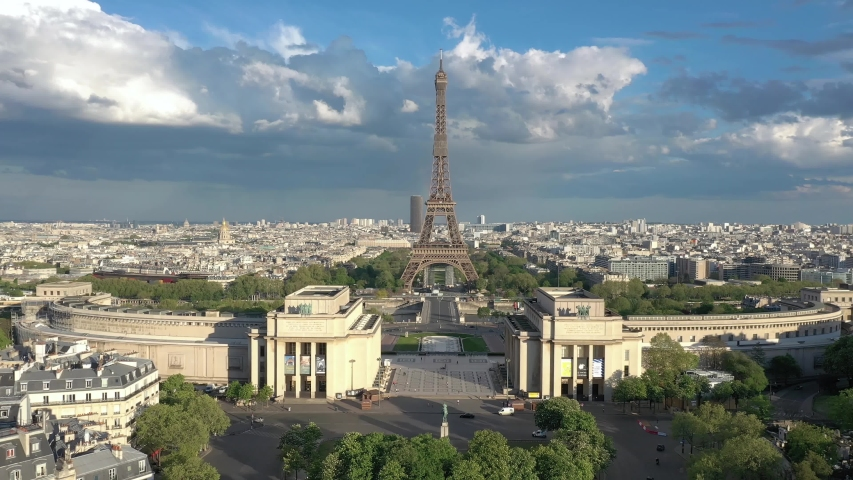 France Paris drone shot, aerial view flying over Trocadero looking at Tour Eiffel (Eiffel tower), cloudy. Cityscape foreward view | Shutterstock HD Video #1055359520