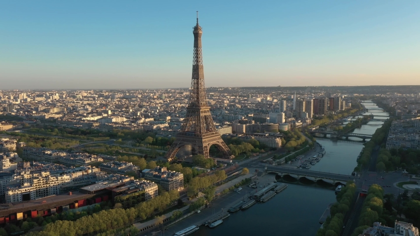 France, Paris Tour Eiffel (Eiffel tower), bridges and Trocadero, at sunset (or sunrise). 4k High Quality drone shot, aerial view above Seine river (looks like helicopter or drone shot).
