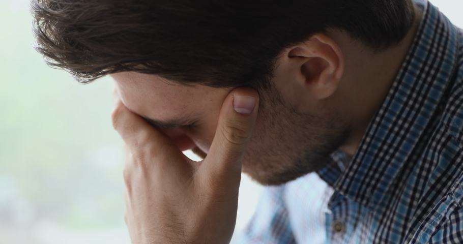 Close up view troubled man bowing his head cover face with hands crying due life grief sorrow, personal troubles, alcohol abuse drug addicted desperate guy need help. Break up, health problems concept Royalty-Free Stock Footage #1055363126