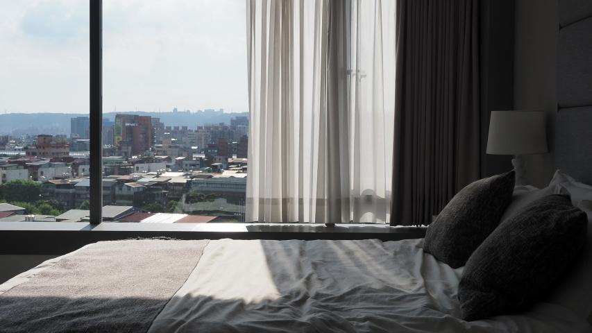 Apartment interior, shady bedroom in sunlight | Shutterstock HD Video #1055363927