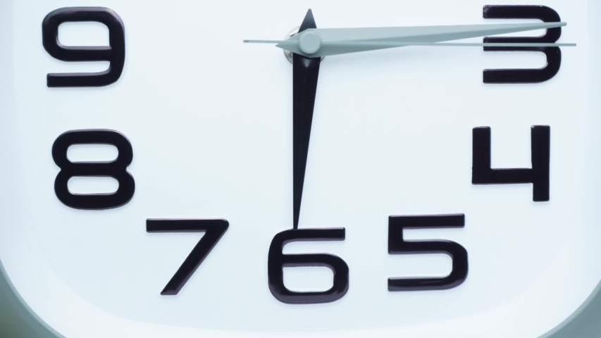 Close up clock beginning of time 06.15 on White background, Time lapse 30 minutes moving fast. | Shutterstock HD Video #1055363984