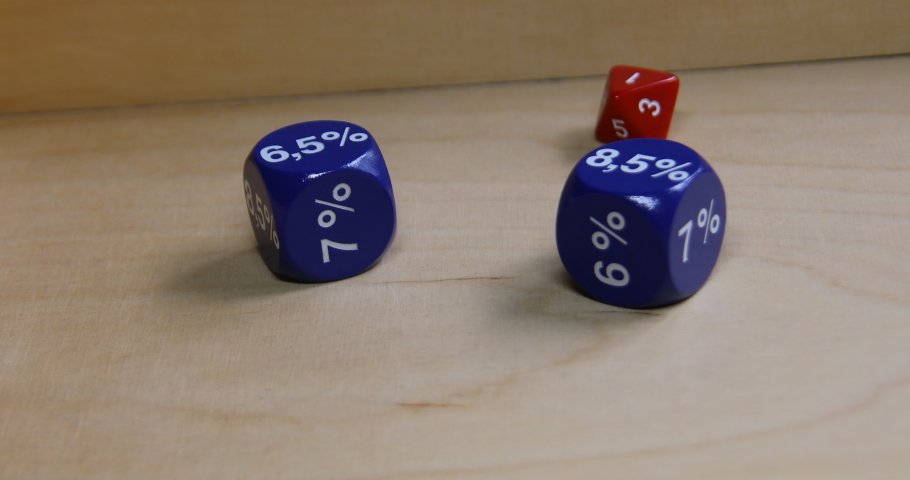 Various dice are thrown on board and roll around | Shutterstock HD Video #1055364152
