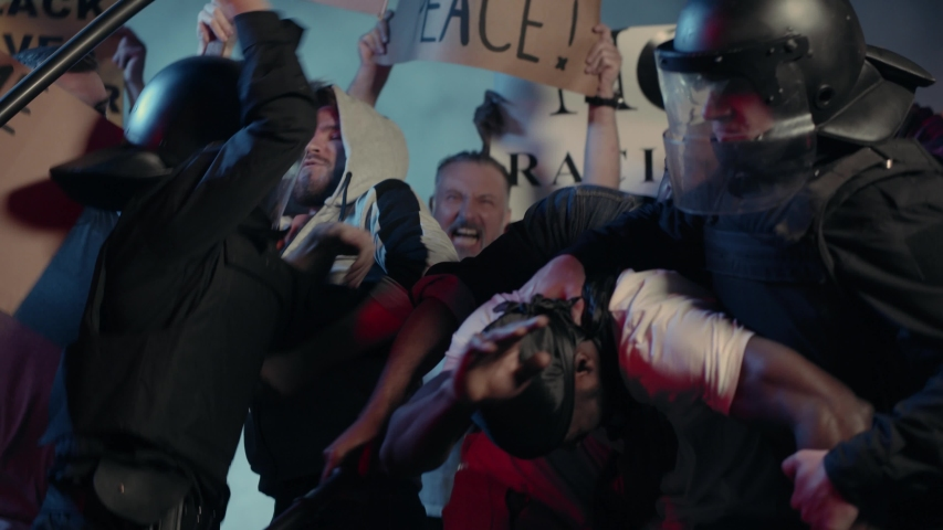 Crowd of Multi-ethnic Furious Strong Men Fighting with Brutal Police Protesting for Human Rights on Street Demstration. Black Lives Matter. Stop Racism. Royalty-Free Stock Footage #1055365034