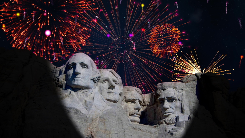 A massive fireworks display over Mount Rushmore national memorial on a clear starry night. | Shutterstock HD Video #1055366762