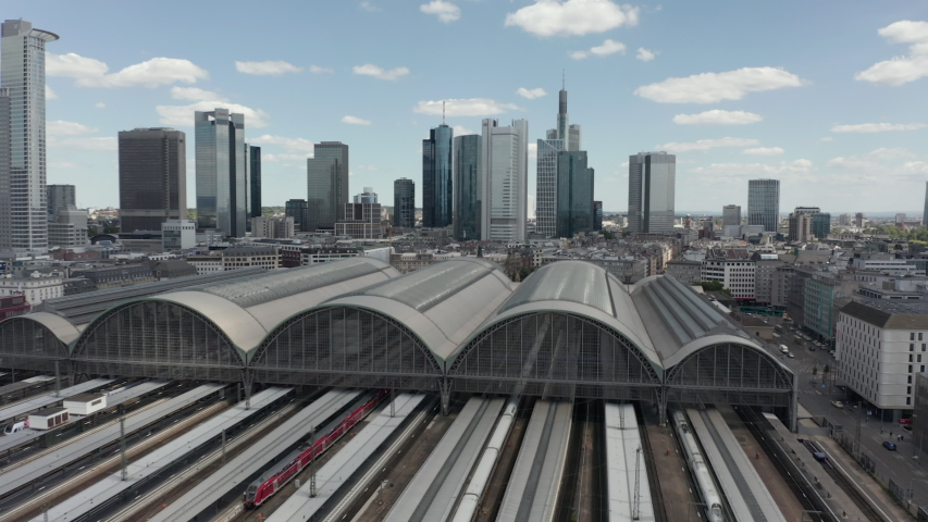 AERIAL: Forward Flight over Frankfurt am Main, Germany Central Train Station Train Tracks with Skyline View in June 2020