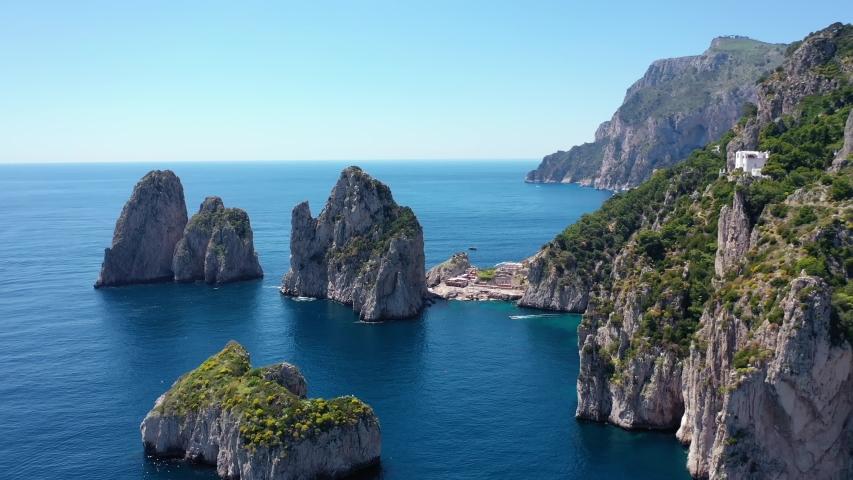 Coastal scene of azure Tyrrhenian Sea, Capri, island of Gulf of Naples, Italy | Shutterstock HD Video #1055374601