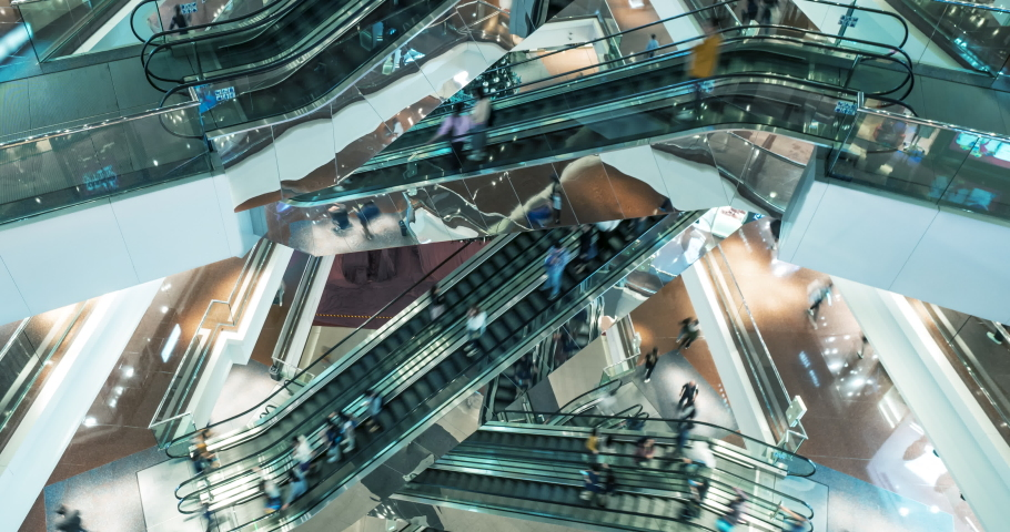 Time lapse escalators in modern shopping mall crowd of people. Very busy full of clients mall complex. Сonsumption concept. Royalty-Free Stock Footage #1055382806