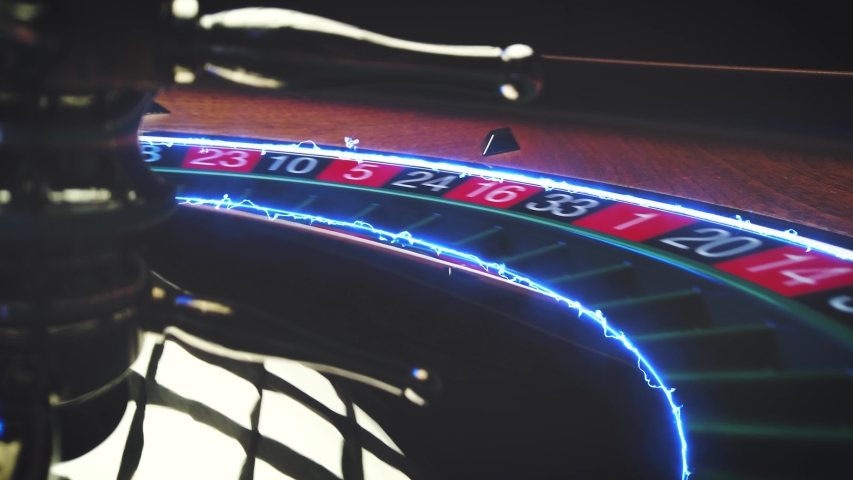 Roulette table close up at the Casino with flaming track - Selective Focus | Shutterstock HD Video #1055383088