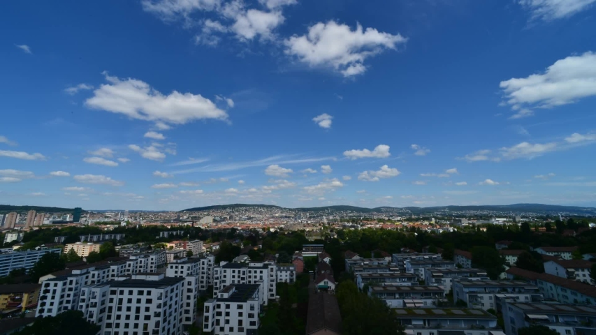 Time lapse shot of Zurich Switzerland with passing white clouds on a summer day | Shutterstock HD Video #1055386058