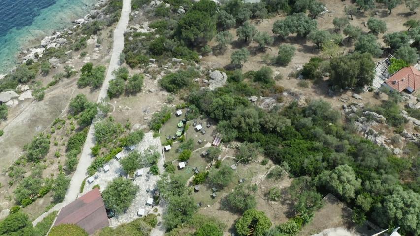 Aerial lift up footage of Mediterranean coastline and blue sea. Chalkidiki, Greece. | Shutterstock HD Video #1055386949