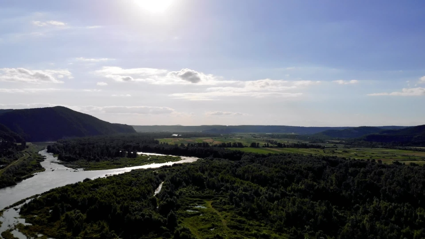 Drone view over the wild flooded river with mountains and beautiful sky in Ukraine. | Shutterstock HD Video #1055387162