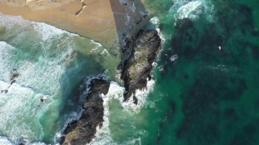 Aerial drone flyover of Glasshouse Rocks at Narooma Beach in Narooma on the New South Wales South Coast, Australia, on a sunny day   | Shutterstock HD Video #1055387819
